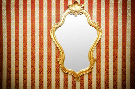 reflection in mirror: Ornate mirror on the wall