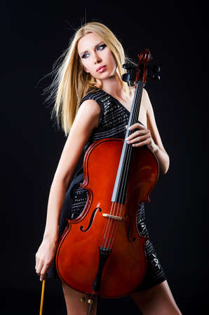 Woman playing cello on white photo