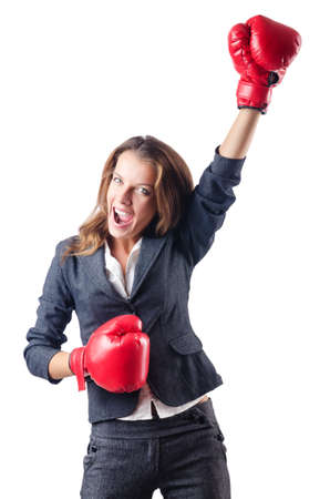 Angry businesswoman with boxing gloves photo