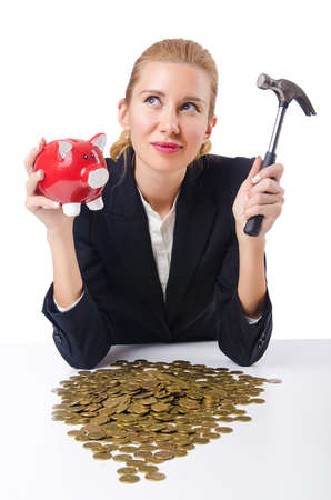 Woman trying to break the piggybank photo
