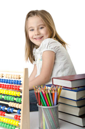 Girl with books and abacus photo