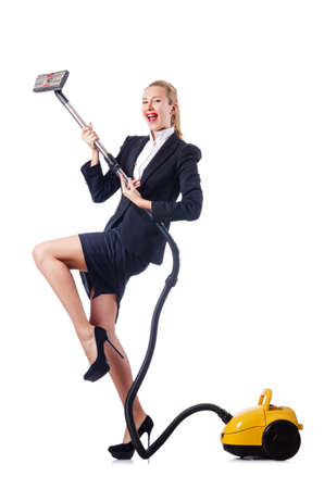 Woman cleaning with vacuum cleaner photo