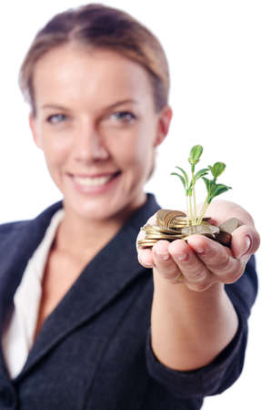Businesswoman with seedlings and coins Stock Photo - 15129564
