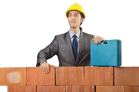 Businessman with bricks on white Stock Photo - 15129610