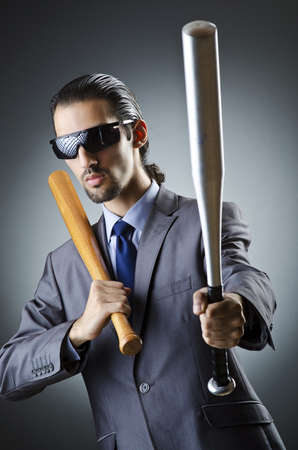 Angry businessman with bat on white photo
