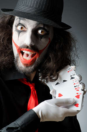 Joker con tarjetas en sesi�n de estudio photo