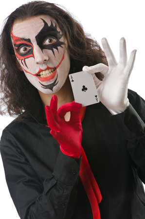 harlequin clown in disguise: Joker with cards isolated on white Stock Photo
