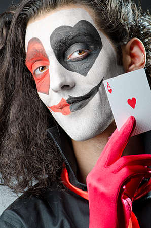 Joker met gezichtsmasker in de studio photo