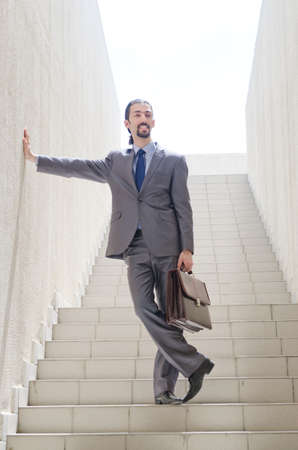 Businessman with stair in business concept Stock Photo - 15531710