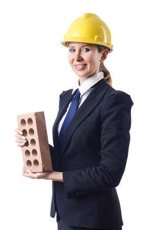 Woman builder with brick on white photo