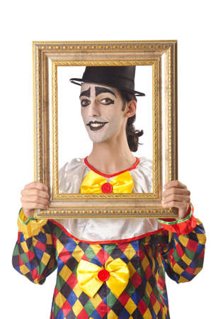 Sad clown on the white photo