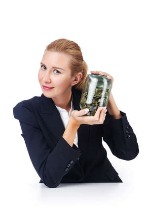 Businesswoman with coins on white photo