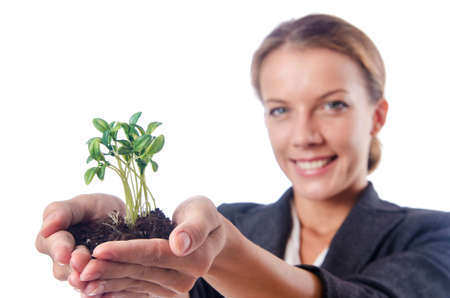 Businesswoman with seedlings and coins photo