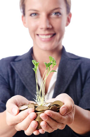 Businesswoman with seedlings and coins Stock Photo - 15440536