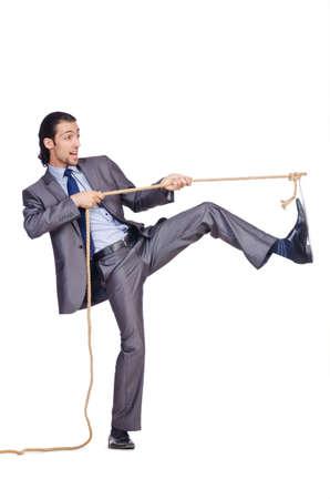 Businessman pulling rope on white photo