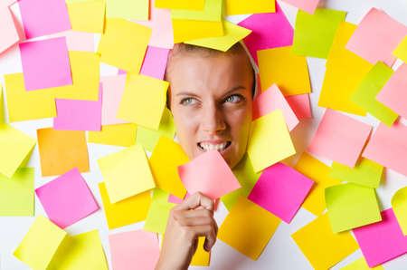 Woman with lots of reminder notes Stock Photo - 15531686