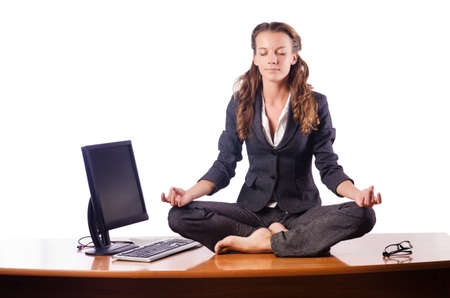 Woman meditating on the desk Stock Photo