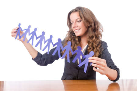 Businesswoman with paper people on white Stock Photo - 15583017
