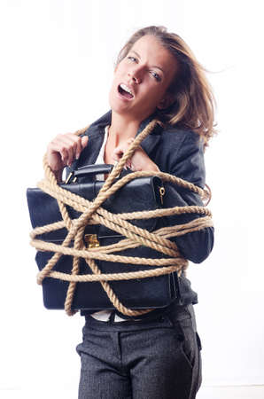 Businesswoman tied with rope on white photo