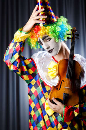 Clown playing on the violin Stock Photo - 15586055