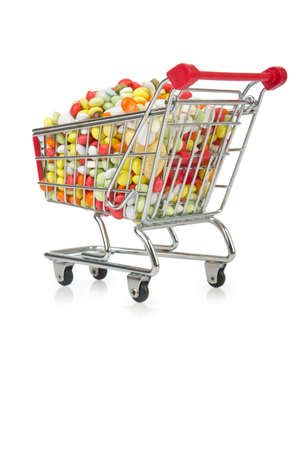 retail therapy: Shopping cart with many colourful pills