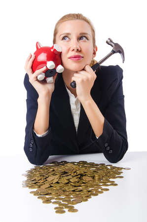 Woman trying to break the piggybank Stock Photo - 15585865