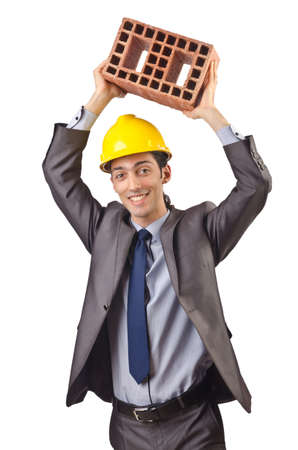 Businessman with bricks on white Stock Photo - 15549986