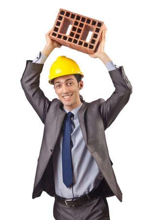 Businessman with bricks on white Stock Photo - 15549986