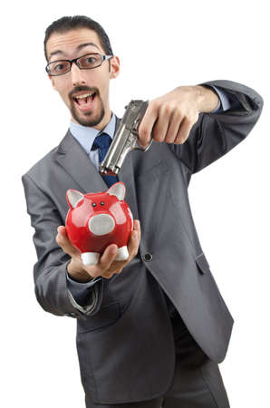 Businessman killing the piggy bank photo