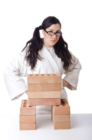 Woman karate breaking bricks on white Stock Photo - 15545470