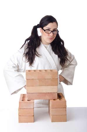 Woman karate breaking bricks on white Stock Photo - 15545470