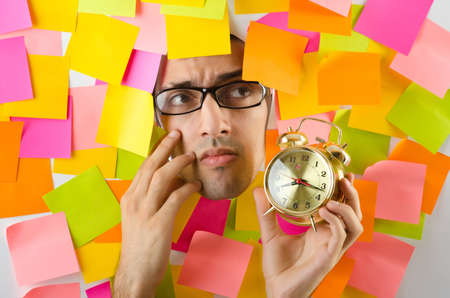 Man's face through paper and reminders Stock Photo - 15570809