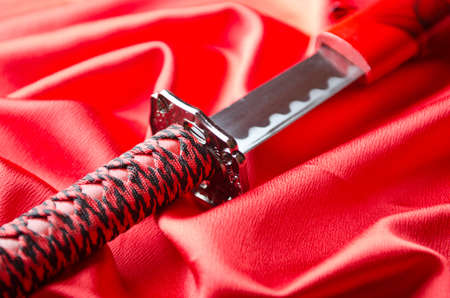 tsuka: Japanese sword takana on red satin background Stock Photo