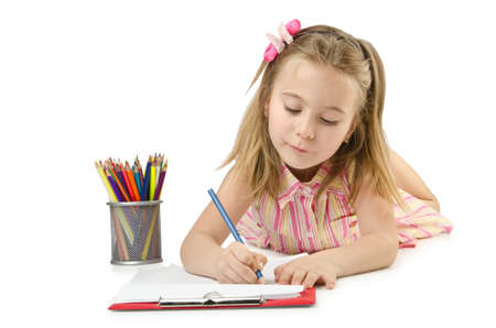 Little girl writing with pencils photo