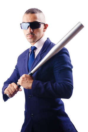 Handsome businessman with bat on white photo