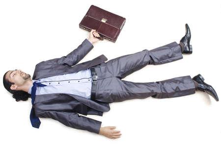 lying on floor: Dead businessman on the floor