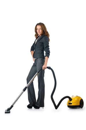 Businesswoman cleaning with vacuum cleaner photo