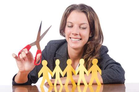 Businesswoman with paper people on white photo