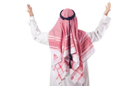 hombre orando: Hombre �rabe rezando en el blanco Foto de archivo