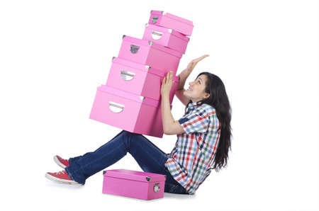 Girl with lots of gifts on white Stock Photo - 15766676