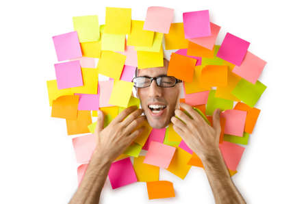 Man's face through paper and reminders Stock Photo - 15766850