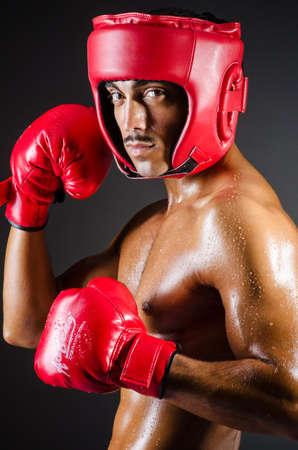 Muscular boxer in studio shooting photo