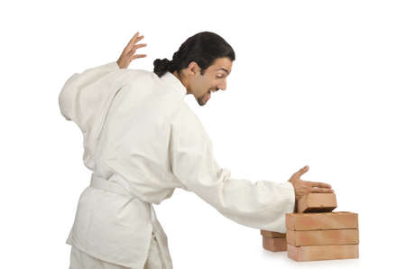 Karate man breaking bricks on white Stock Photo - 15766714