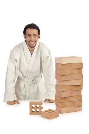Karate man breaking bricks on white Stock Photo - 15766766
