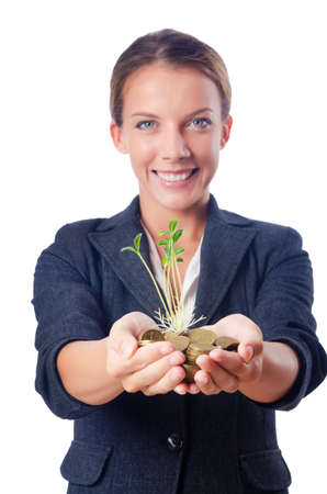 Businesswoman with seedlings and coins Stock Photo - 15766893