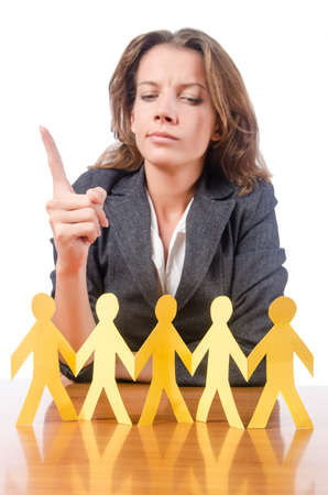 Businesswoman with paper people on white Stock Photo - 15766919