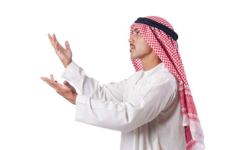 Arab man praying on the white photo