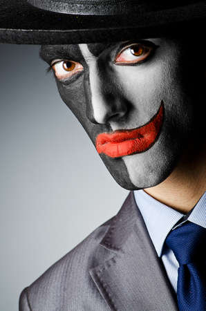 male costume: Businessman with clown face paint
