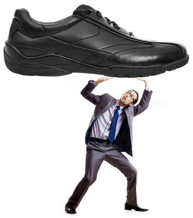 under pressure: Woman domination concept with shoes and man Stock Photo