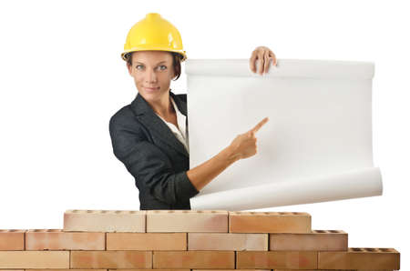 Businesswoman with drawings near brick wall photo